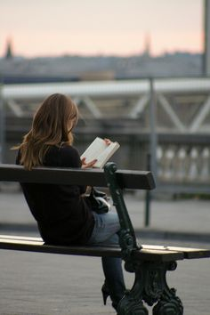 Create this character. Who is she? Why is she reading here? I think she could be waiting to meet someone.
