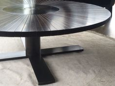 Segmented table with Braille Inscribed centre.