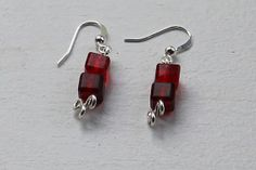 These earrings are made with two square beads featuring different shades of red with a flower design at the bottom. https://www.etsy.com/listing/162790911/small-simple-dangling-two-tone-red?ref=shop_home_active_8