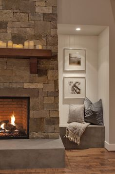 Wood mantle on stone fireplace. Love the base of the fireplace-Woodinville Retreat contemporary family room Home Living Room, Living Room Designs, Fireplace Design, Fireplace Stone, Fireplace Mantle, Concrete Fireplace, Fireplace Ideas, Wood Mantle, Concrete Bench