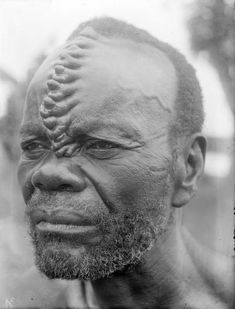 Africa | A Boko man from DR Congo, with characteristic 'cockscomb' scarification that was obtained by carving the same places several times. | © Auguste M Bal, ca. early 1930s