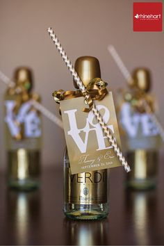 Mini champagne bottles with chevron straws. Cute for either a bridal shower gift or as a wedding favor for the guests.