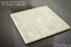 Turning a piece of off the shelf tile into a gorgeous marble trivet is easier and faster than you may think!