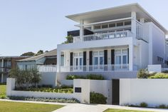 …Floating roof forms shelter this casual beach house where contemporary lines combine with character elements enhanced by white timber linings to form the essence of beachside living