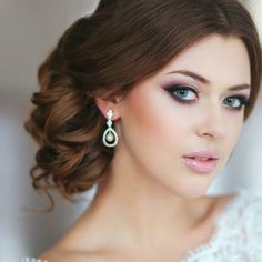 21 Classy and Elegant Wedding Hairstyles - MODwedding...this hair and make up