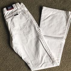 "Just USA White Flare Jeans 7 Button fly, flare jeans. White. These are clean but may have some dirt, although I couldn't find any. Crisp denim made in the USA! Waist: 14"" rise: 9"" inseam: 32"". No trades. Open to all offers. :) Just usa Jeans Flare & Wide Leg"