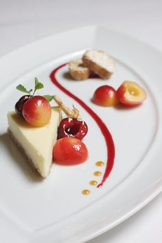 Chevre Cheesecake with poached cherries and cherry coulis plating Laur. - Chevre Cheesecake with poached cherries and cherry coulis plating Laura Chenel's Chevre - Fancy Desserts, Gourmet Desserts, Plated Desserts, Gourmet Recipes, Delicious Desserts, Dessert Recipes, Yummy Food, Yummy Lunch, Gourmet Foods