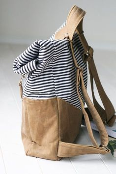 A vintage style rucksack with fresh, modern detail... Pack up this stylish and versatile bag with everything you need for the day! Arms full of toddlers or groceries? Carry the rucksack on your back! Pattern includes step-by-step full color photos and illustrations, along with