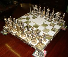 A 20th century bronze Napoleonic chess set by Piero Benzoni, Italy 1994, with figures finished in silver and gilt. The same make of chess set used in the Frasier episode Chess Pains.
