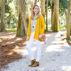 Mustard cardigan, navy stripes, white jeans, cognac shoes, gold jewelry