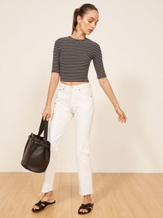 If you don't have one, probably you need one. This is a slightly cropped top with 3/4 length sleeves and a high crew neckline.