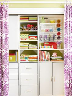 Closet converted into an organized space for crafts, wrapping paper, etc. (one of 16 ideas for creating a tidy craft area in a guest room)