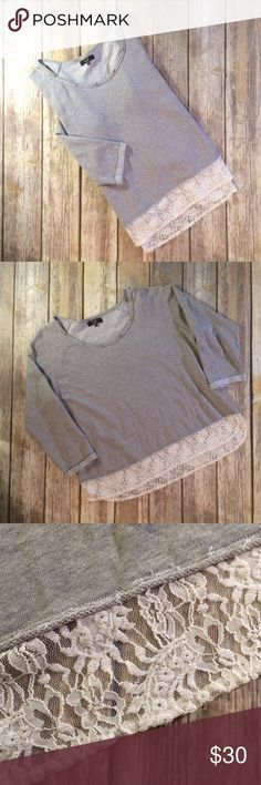 """EARL JEANS Lace Hem & Crystal Sweatshirt Petite XL EARL JEANS Lace Hem & Crystal Embellished Neckline Sweatshirt in light heather gray with 3/4 length sleeves and raw edges. Petite XL. Boxy fit with high low Hem. Like new condition. Bust, waist and hips measure 22 1/2"""" flat across front. (Double measurements or compare to a similar garment you own while laying flat unstretched.) Length from top of shoulder to hem is 24"""" in front, 26"""" in back. Offers welcome. Earl Jeans Tops Sweatshirts…"""