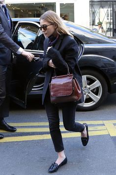 WHO: Ashley Olsen WHAT: The Row bagWHERE: On the street, ParisWHEN: March 6, 2014