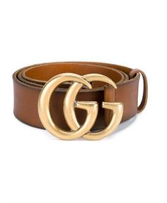 This brown leather Gucci leather logo belt is a classic and timeless accessory from the brand, featuring a thick adjustable strap and gold-tone double 'G' logo buckle. Wear yours to add a flash of the brand's vintage aesthetic to your off-duty weekend looks. This belt is also available in black.