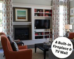 Fireplace and TV Wall in Model Home | hookedonhouses.net - love the curtains