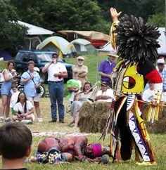 The Hunter, performed by Robert Tucker a descendant of Sparrowhawk and Sarah Persinger , gives thanks to the Creator for the deer during a performance of the Deer Dance in the Native American circle during the annual Trade Days Festival in Trade TN, June, 2003. - photo by Patsy McKee