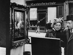 Look where his eyes are going. doisneau photography