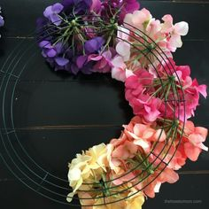 Learn how to make a hydrangea wreath using a wire wreath form and beautiful faux hydrangeas. This gorgeous rainbow hydrangea wreath can also be done in any color combination you prefer. Its a quick and easy DIY and the perfect colorful summer wreath! Tulip Wreath, Hydrangea Wreath, Floral Wreaths, Burlap Wreaths, Mesh Wreaths, Cheap Wreaths, How To Make Wreaths, Corona Floral, Wire Wreath Forms