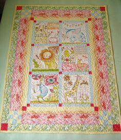http://delphinarose.wordpress.com/2014/10/01/hello-world-baby-quilt/