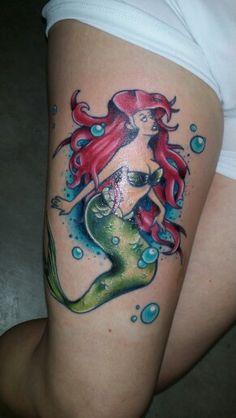 Ariel inspired mermaid tattoo.
