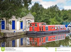 Peaceful landscape with a red canal boat reflecting in the still canal. Description from dreamstime.com. I searched for this on bing.com/images