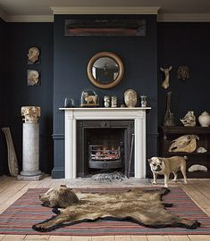 love the wall color, the white accents, and the bear rug. Bear Skin Rug, Bear Rug, Decoration Chic, Navy Walls, Black Walls, Fireplace Accessories, Dark Interiors, Living Spaces, Living Room