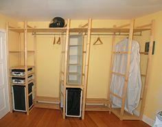 Custom closet using Ikea Ivar shelves and mounted Vågen curtain rods to hang clothes.