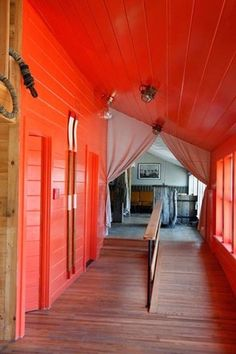 i like the idea of a red hallway/building front