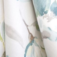 A gorgeous, large scale watery floral fabric in teal, cream, grey and a touch of yellow-green on a soft putty grey background.Perfect for drapery, roman blinds