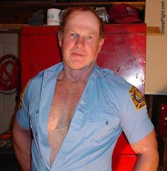 a fireman removing shirt hairychest