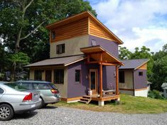 This is a modern zen cabin in West Asheville. From the outside, you'll notice purple, sage green, and pine siding as well as geometrical roof lines. When you go inside, you'll find a li…
