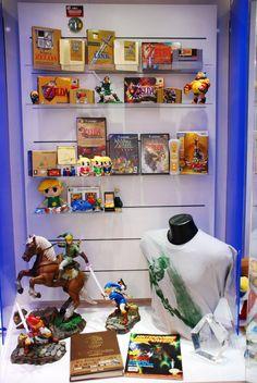 Legend of Zelda Franchise Cabinet at Nintendo World.... I want that big epona and link statue....