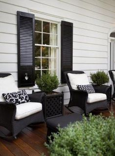 Paint shutters black to match wicker and black front door? would look great with white shutters and window sills and a grey house! by DeeDeeBean