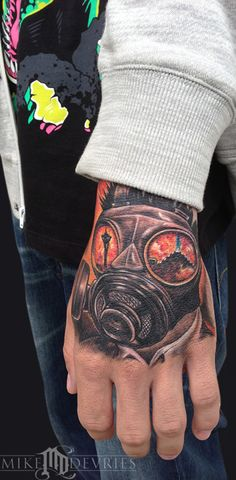 #kris Mike DeVries - Gas Mask Tattoo. Dont like the angle but the reflected eyes is something to consider.