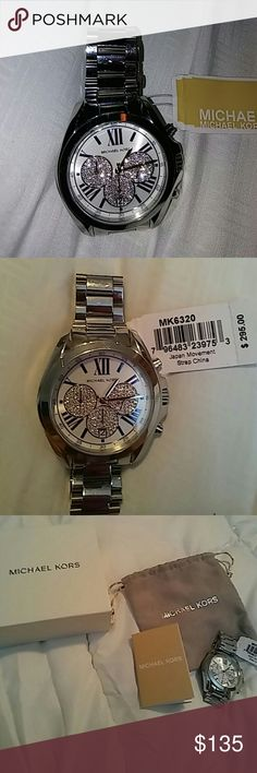 Watch Silver Michael Kors watch with Mickey Mouse face. Roman numerals in in blue. Absolutely gorgeous. Just to big and I don't want to have any links removed. Brand new with tags. I never got to wear it. Comes in original box with instructions book and dust bag. Michael Kors Accessories Watches