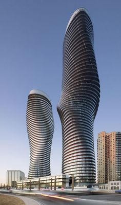 An artist's rendering of the soon-to-be completed Absolute Towers, a residential project in Mississauga, Ontario. The towers have been named the Best Tall Building in Americas by the Chicago-based Council on Tall Buildings and Urban Habitat (CTBUH). Unusual Buildings, Amazing Buildings, Modern Buildings, Famous Buildings, Future Buildings, Office Buildings, Modern Houses, Architecture Unique, Futuristic Architecture