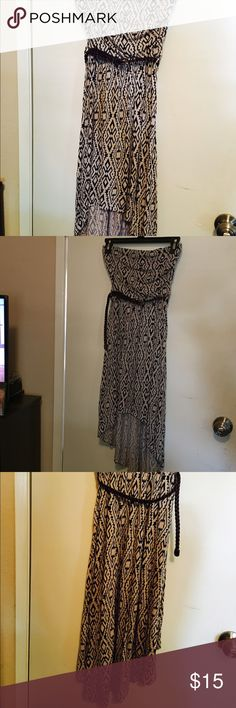 Black and Tan print dress iris low angeles Strapless Black and Tan print dress. Shorter in the front and longer in the back. Mid lengthy. Iris brand size medium with brown belt. Worn a couple times Iris los angeles  Dresses High Low