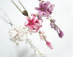 Pink Lily necklace, Pink flower pendant, Lily pendant, Polymer clay Jewelry, flower necklace, Wedding Jewelry, handmade jewelry  This Lily necklace is really beautiful. It is very feminine and delicate. I used brass wire to fix pearls and hand sculpted polymer clay lilies and buds. It is hanged on brass chain. It is great accessory for summer time. This flower pendant can be a perfect gift for Valentins day or birthday. Polymer clay flowers after baking to a permanent hardness become very…