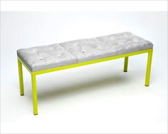 """Tufty"" a bench with cast concrete pillows on a powder coated frame."