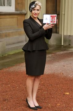 Kate winslet wearing an Alexander McQueen suit to collect her CBE from Buckingham Palace