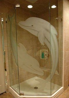 I would love to do this in my bathroom to replace boring frosted glass shower doors that have ugly limescale deposits. Nautical Room Decor, Coastal Decor, Dolphin Bedroom, Beach Theme Bathroom, Bathroom Ideas, Coastal Bathrooms, Beach Themes, Ocean Themes, Coastal Homes