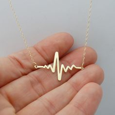 Heartbeat necklace for a nurse, mother to be or someone special. 10k Solid heart beat necklace at AgHalo.com