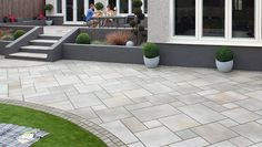 Ethically sourced sandstone garden paving from Marshalls available as setts, walling and step units for perfect design co-ordination.