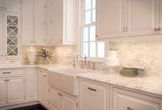 Kitchen Backsplash Ideas. Backsplash tiles are 3″ x 6″ Calacutta Gold marble and the countertop is Calacutta Gold as well. #Kitchen #Backsplash #Marble