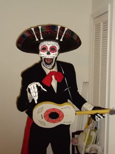 looks like a half mask on a hat here - This is what I am going to do for Dave : dead mariachi costume  - Germanpascual.Com