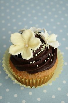 Chocolate icing with ivory veined petunia flowers with pearl and non pareils