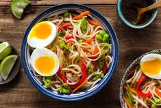 Asian rice noodle bowls with sesame dressing and soft-cooked eggs
