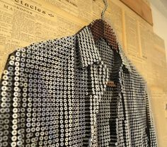 """It's been a long day,"" Myers made a 4 foot by 4 foot sculpture of a men's dress shirt. It consists of 6,500 screws, oil paint, French newspaper clippings from the 1910's to 30's, and wood"