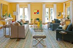 From a striking red dining room to a beachy teal bedroom, these colorful spaces from Dering Hall interior designers prove that going bold always pays off. Hall Interior, Interior Design Living Room, Most Popular Paint Colors, Room Wall Painting, Yellow Walls, Yellow Sofa, Elle Decor, Room Colors, Contemporary Furniture